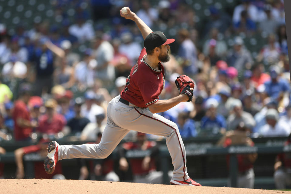 Arizona Diamondbacks starter Caleb Smith delivers a pitch during the first inning of a baseball game against the Chicago Cubs, Sunday, July 25, 2021, in Chicago. (AP Photo/Paul Beaty)