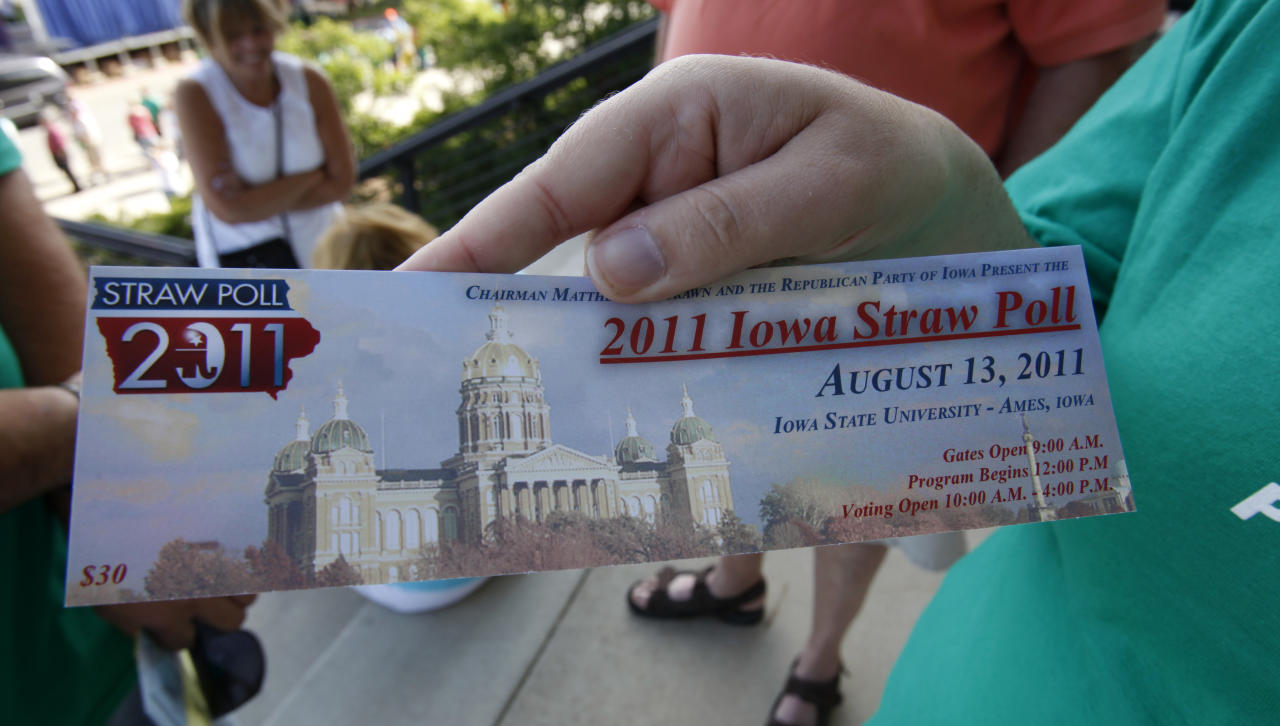 A Tim Pawlenty supporter holds a ticket while standing in line outside Hilton Coliseum before casting a ballot in the Iowa Republican Party's Straw Poll, Saturday, Aug. 13, 2011, in Ames, Iowa. (AP Photo/Charlie Neibergall)