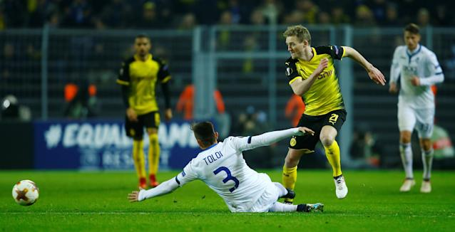 Soccer Football - Europa League Round of 32 First Leg - Borussia Dortmund vs Atalanta - Signal Iduna Park, Dortmund, Germany - February 15, 2018 Borussia Dortmund's Andre Schurrle in action with Atalanta's Rafael Toloi REUTERS/Leon Kuegeler