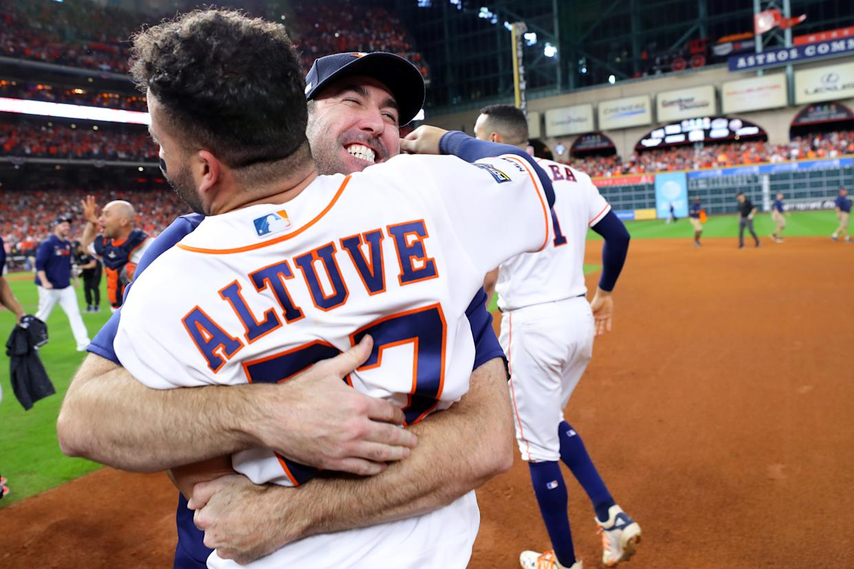 HOUSTON, TX - OCTOBER 19:  Jose Altuve #27 of the Houston Astros celebrates with Justin Verlander #35 after hitting a two-run walk-off home run to win the ALCS and advance the Houston Astros to the World Series during the ninth inning of Game 6 of the ALCS between the New York Yankees and the Houston Astros. The Astros defeated the Yankees 6-4 at Minute Maid Park on Saturday, October 19, 2019 in Houston, Texas. (Photo by Alex Trautwig/MLB Photos via Getty Images)