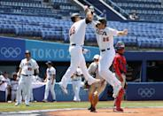 <p>USA's Triston Casas and Tyler Austin celebrate Casas's two-run home run in the first inning during the knockout stage of men's baseball.</p>