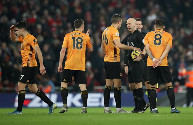 "Soccer Football - Premier League - Liverpool v Wolverhampton Wanderers - Anfield, Liverpool, Britain - December 29, 2019 Wolverhampton Wanderers' Conor Coady appeals to referee Anthony Taylor Action Images via Reuters/Carl Recine EDITORIAL USE ONLY. No use with unauthorized audio, video, data, fixture lists, club/league logos or ""live"" services. Online in-match use limited to 75 images, no video emulation. No use in betting, games or single club/league/player publications. Please contact your account representative for further details."