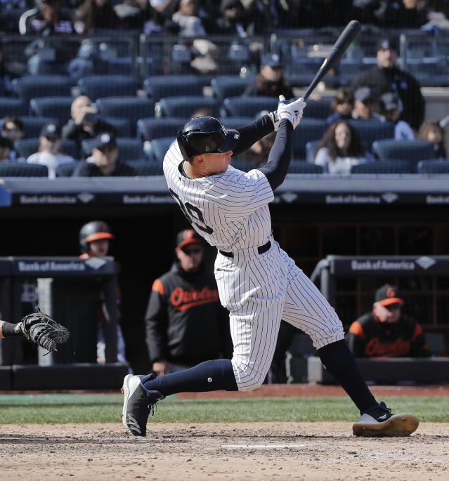 New York Yankees' Aaron Judge (99) connects for an RBI double against the Baltimore Orioles during the seventh inning of a baseball game, Saturday, April 7, 2018, in New York. (AP Photo/Julie Jacobson)