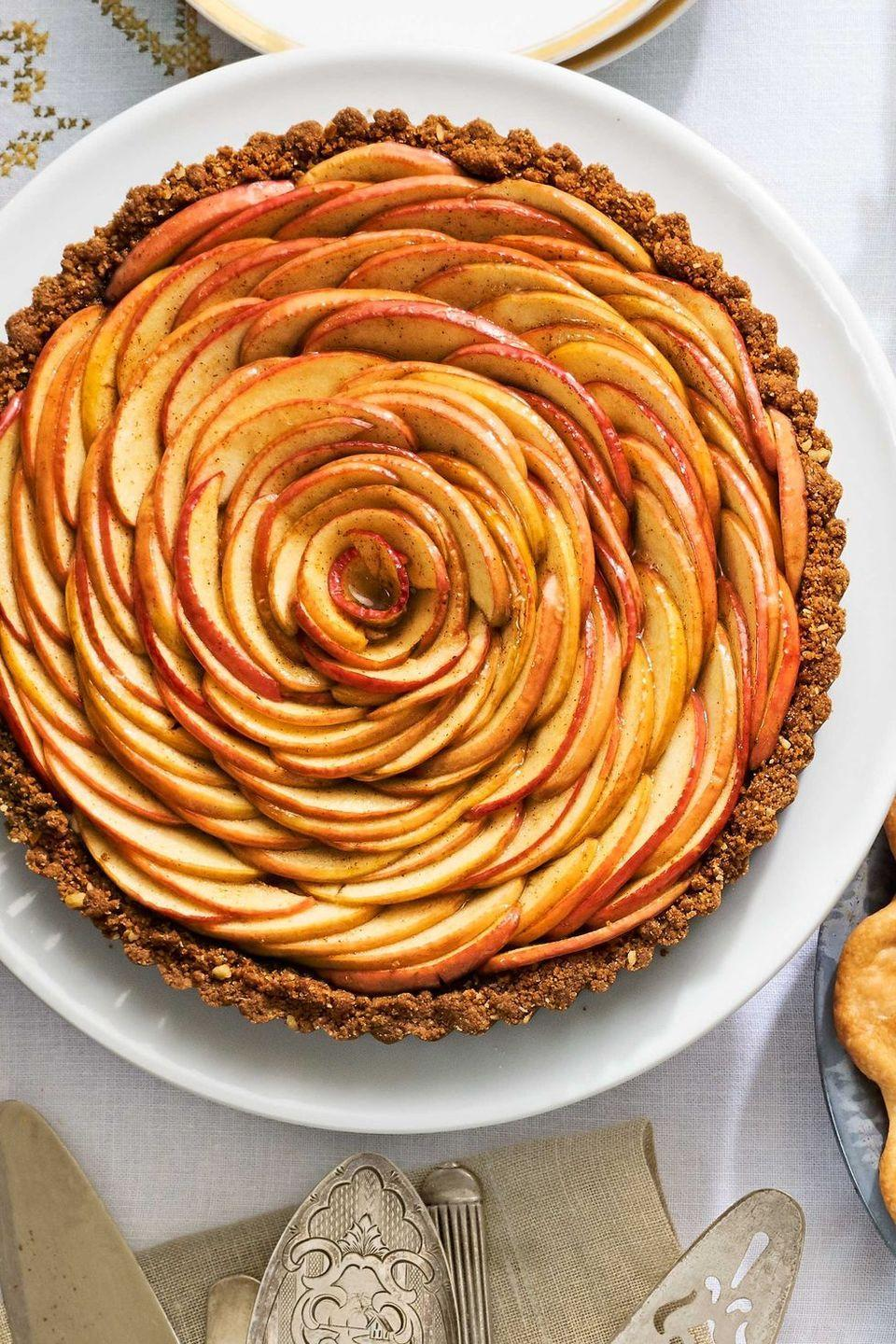 "<p>Go ahead and claim the title Thanksgiving MVP with this epic tart; you deserve it. </p><p><em><a href=""https://www.countryliving.com/food-drinks/recipes/a40043/apple-blossom-tart-recipe/"" rel=""nofollow noopener"" target=""_blank"" data-ylk=""slk:Get the recipe from Country Living »"" class=""link rapid-noclick-resp"">Get the recipe from Country Living »</a></em></p><p><strong>RELATED: </strong><a href=""https://www.goodhousekeeping.com/food-recipes/dessert/g768/apple-dessert-recipes/"" rel=""nofollow noopener"" target=""_blank"" data-ylk=""slk:40 Apple Desserts That Are Delicious to the Core"" class=""link rapid-noclick-resp"">40 Apple Desserts That Are Delicious to the Core</a></p>"