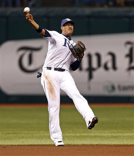 Tampa Bay Rays shortstop Yunel Escobar tries to throw out Cleveland Indians' Michael Bourn during the first inning of a baseball game, Friday, April 5, 2013, in St. Petersburg, Fla. (AP Photo/Mike Carlson)