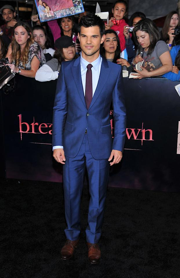 "Taylor Lautner arrives at the red carpet premiere for ""The Twilight Saga: Breaking Dawn – Part 1"" in Los Angeles, CA. (Photo by Vince Bucci/Yahoo!)"