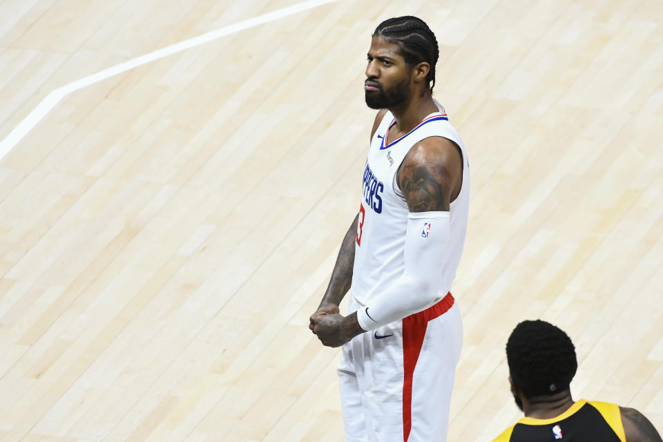 Paul George flexes and does a mean mug to celebrate a bucket.
