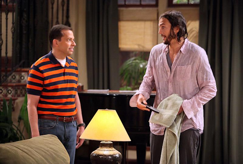 "In this image released by CBS, Jon Cryer portrays Alan Harper, left, and Ashton Kutcher portrays Walden Schmidt in Kutcher's debut on the CBS comedy ""Two and a Half Men,"" which aired Monday, Sept. 19, 2011. (AP Photo/CBS, Danny Feld) MANDATORY CREDIT; NO ARCHIVE; NO SALES; FOR NORTH ANMERICAN USE ONLY."