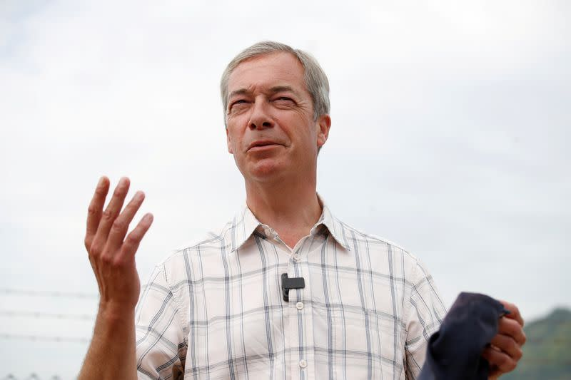 FILE PHOTO: British Brexit Party leader Nigel Farage speaks during a visit at Dover harbour, in Dover