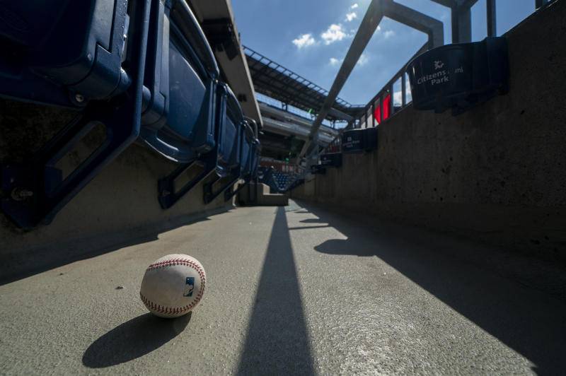 A foul ball that was hit into the stands sits on the ground of an empty stadium during the eight inning of a baseball game between the Miami Marlins and the Philadelphia Phillies, Sunday, July 26, 2020, in Philadelphia. The Marlins won 11-6. (AP Photo/Chris Szagola)