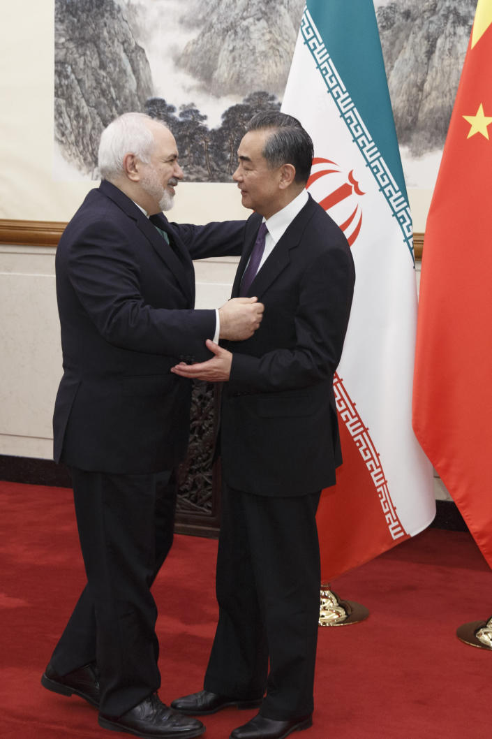 Chinese Foreign Minister Wang Yi, right, meets Iranian Foreign Minister Mohammad Javad Zarif at the Diaoyutai State Guesthouse in Beijing, Friday, May 17, 2019. (Thomas Peter/Pool Photo via AP)
