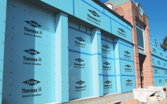 Building covered in blue Dow thermal protection wrap.