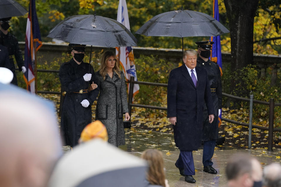 President Donald Trump and first lady Melania Trump arrive to participate in a Veterans Day wreath laying ceremony at the Tomb of the Unknown Soldier at Arlington National Cemetery in Arlington, Va., Wednesday, Nov. 11, 2020. (AP Photo/Patrick Semansky)