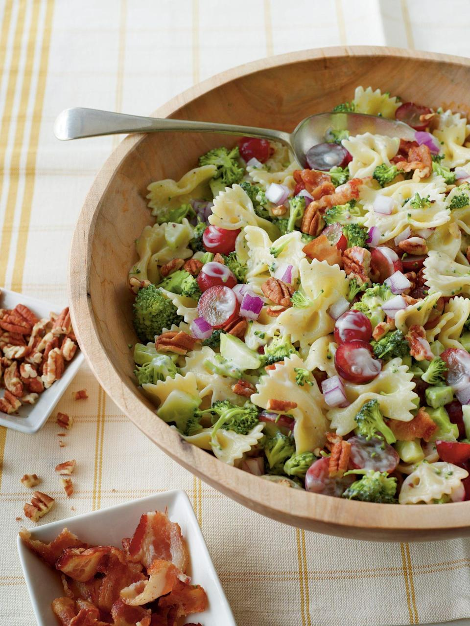 """<p><strong>Recipe:</strong> <a href=""""https://www.southernliving.com/syndication/broccoli-grape-pasta-salad"""" rel=""""nofollow noopener"""" target=""""_blank"""" data-ylk=""""slk:Broccoli, Grape, and Pasta Salad"""" class=""""link rapid-noclick-resp"""">Broccoli, Grape, and Pasta Salad</a></p> <p>The creaminess of pasta salad meets your favorite broccoli salad in this fan-favorite dish. This make-ahead side is a staple in any Southern hostess' recipe book.</p>"""