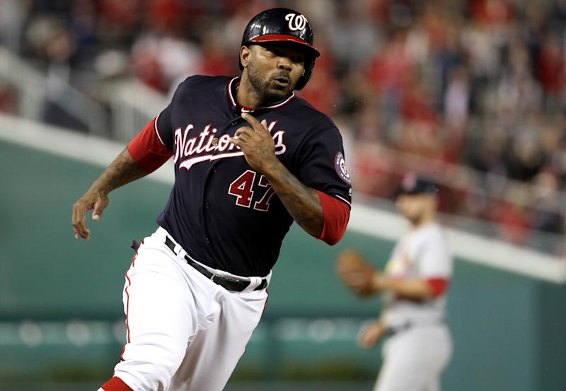 WASHINGTON, DC - OCTOBER 14: Howie Kendrick #47 of the Washington Nationals runs the bases to score after Ryan Zimmerman #11 hit a single in the seventh inning of game three of the National League Championship Series against the St. Louis Cardinals at Nationals Park on October 14, 2019 in Washington, DC. (Photo by Patrick Smith/Getty Images)