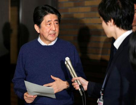 Japan's PM Abe speaks to the media after phone talks with U.S. President Trump at Abe's official residence in Tokyo
