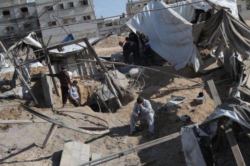 Palestinians survey the damage to a smuggling tunnel after it was targeted in an Israeli air strike in Rafah, in the southern Gaza Strip in February 2012. Israel's Shin Bet said on Wednesday it was holding a Palestinian from the Gaza Strip who was allegedly involved in planning a suicide attack and the kidnapping of an Israeli soldier