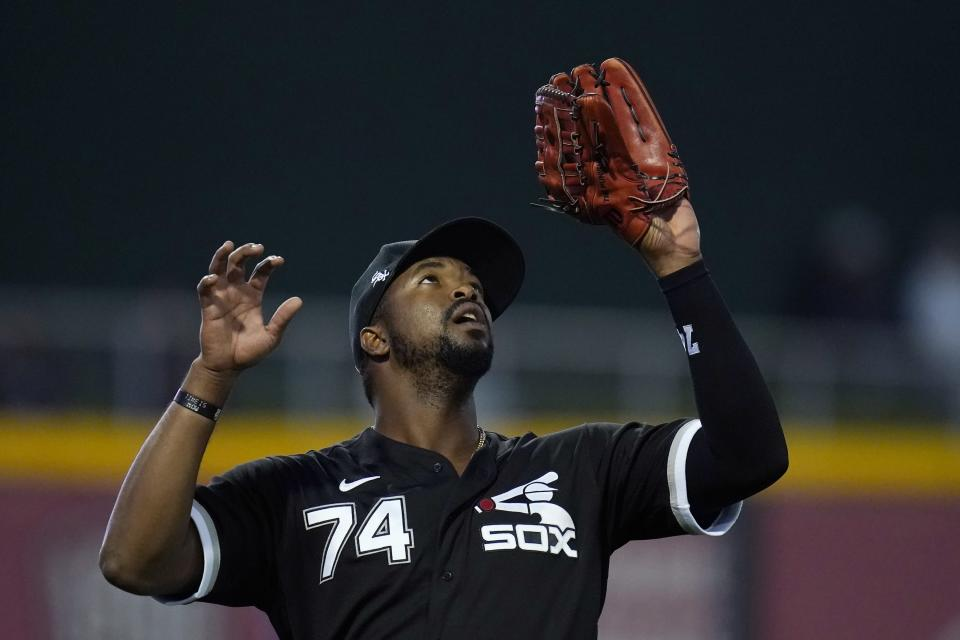 Chicago White Sox left fielder Eloy Jimenez reaches up to make a catch on a fly ball hit by Cincinnati Reds' Tyler Naquin during the second inning of a spring training baseball game Thursday, March 11, 2021, in Goodyear, Ariz. (AP Photo/Ross D. Franklin)