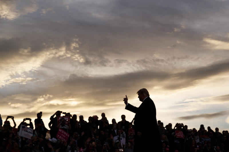 President Donald Trump arrives as the sun sets to speak at a campaign rally at Minuteman Aviation Hangar, Thursday, Oct. 18, 2018, in Missoula, Mont. (AP Photo/Carolyn Kaster)