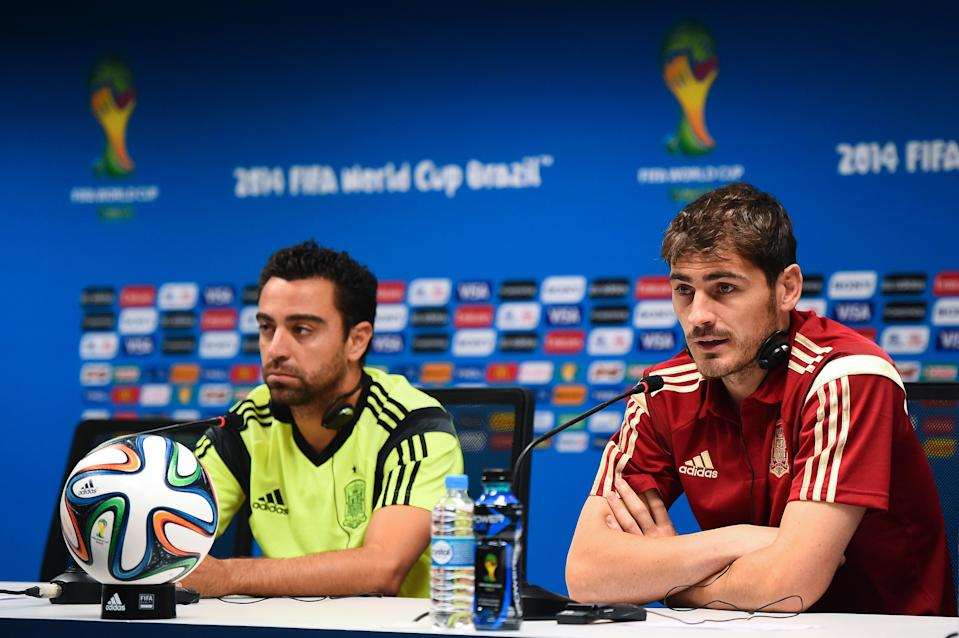 SALVADOR, BRAZIL - JUNE 12:  Xavi Hernandez (L) and Iker Casillas of Spain face the media during the Spain press conference ahead the 2014 FIFA World Cup Group B match between Spain and Netherlands at Arena Fonte Nova on June 12, 2014 in Salvador, Brazil.  (Photo by David Ramos/Getty Images)