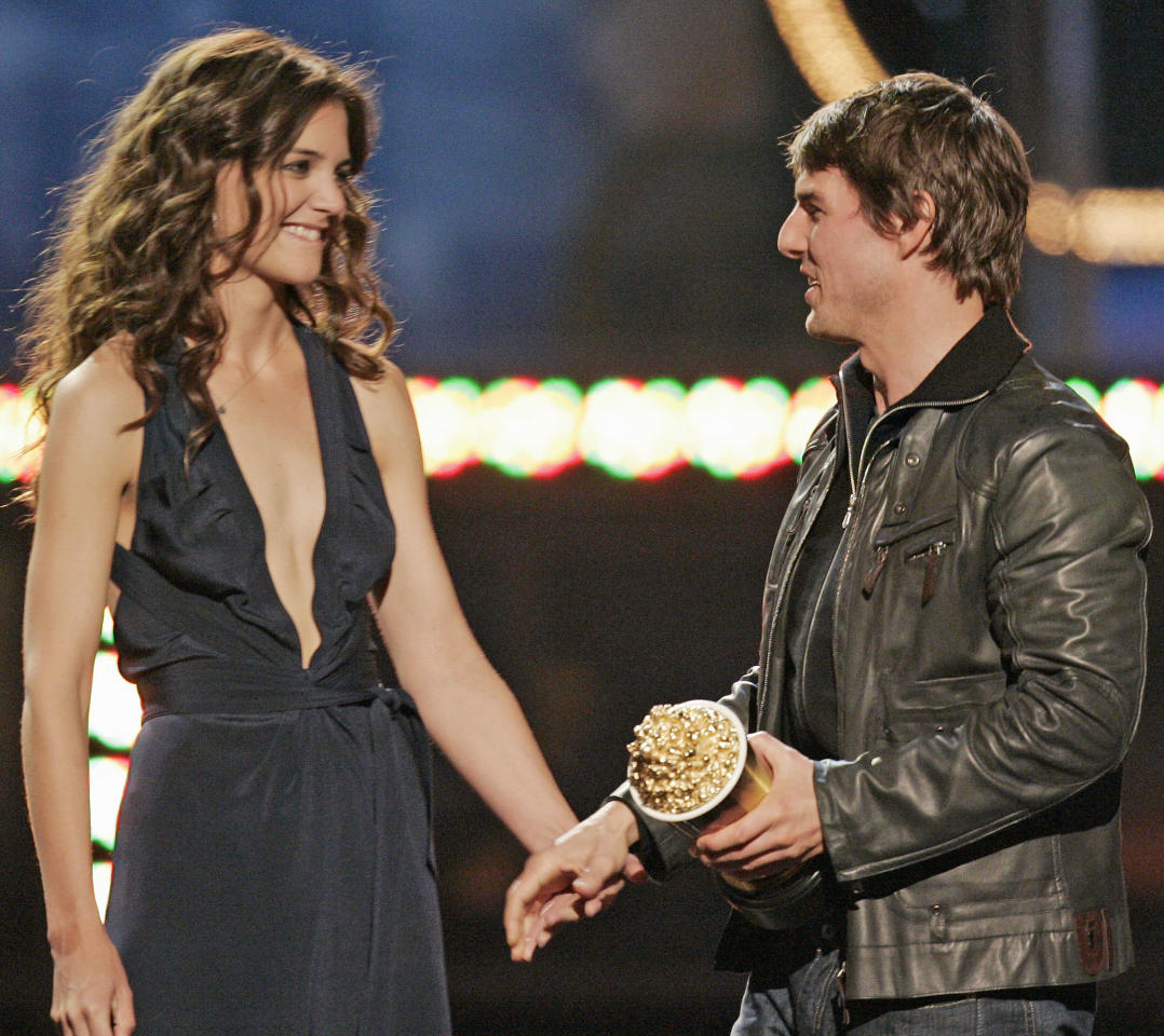 FILE - In this Saturday, June 4, 2005 file photo, Tom Cruise, right, reaches for the hand of his girlfriend Katie Holmes after accepting the MTV Generation award, during the MTV Movie Awards, in Los Angeles. Cruise and Homes are calling it quits after five years of marriage. Holmes' attorney Jonathan Wolfe said Friday June 29, 2012 that the couple is divorcing, but called it a private matter for the family. (AP Photo/Mark J. Terrill, File)