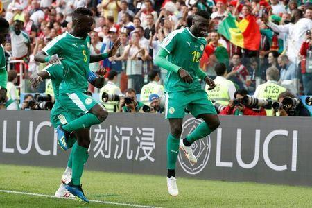 Senegal's M'Baye Niang celebrates scoring their second goal with Idrissa Gueye REUTERS/Grigory Dukor