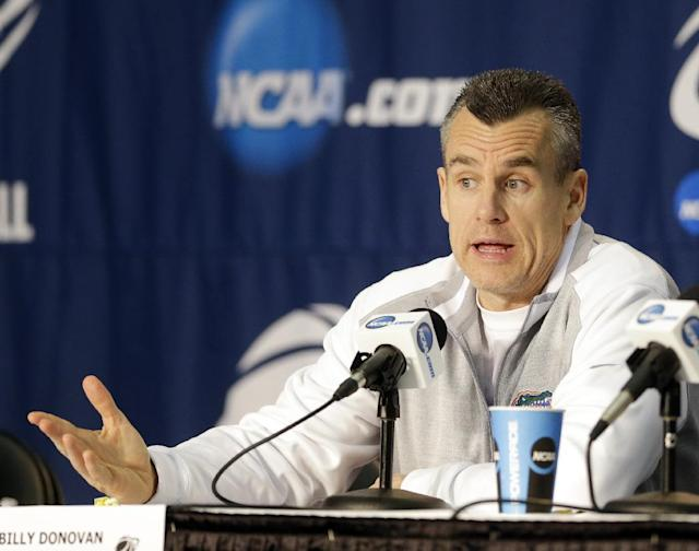 Florida head coach Billy Donovan answers questions at a news conference for the NCAA college basketball tournament in Orlando, Fla., Wednesday, March 19, 2014. Florida plays against Albany in a second round game on Thursday. (AP Photo/John Raoux)