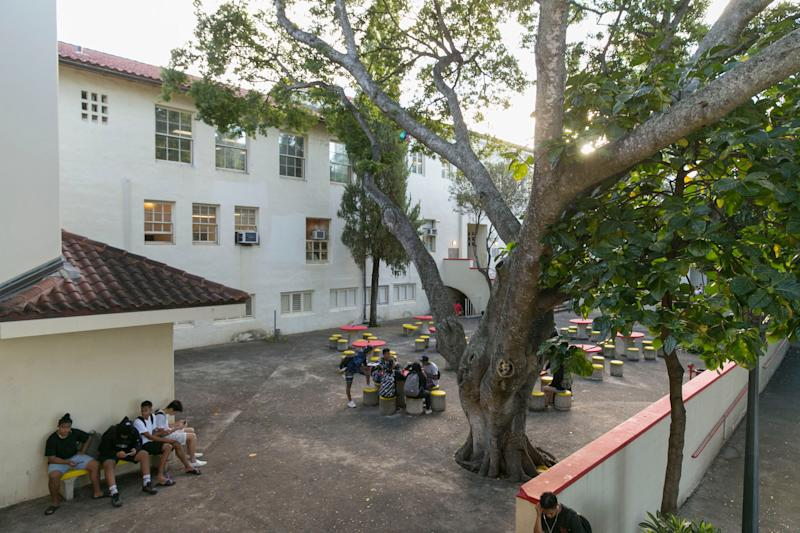 Students mingle in a courtyard before the start of the school day at Roosevelt High School.