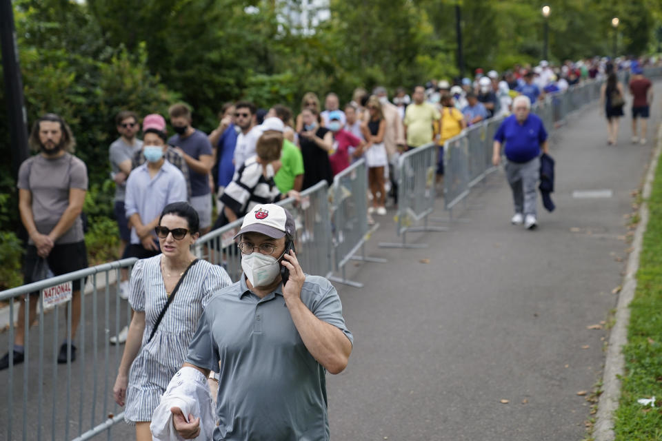 Tennis fans line up outside the Billie Jean King National Tennis Center to attend the first round of the US Open tennis championships, Monday, Aug. 30, 2021, in New York. (AP Photo/John Minchillo)