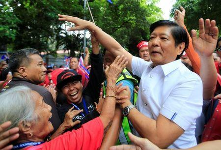 "Ferdinand ""Bongbong"" Marcos, son of late dictator Ferdinand Marcos, greets his supporters upon arrival at the Supreme Court in Padre Faura"