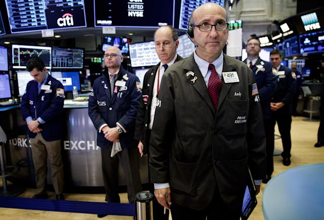 <p>Traders pause during a moment of silence for the victims of yesterday's church shooting in Texas on the floor of the New York Stock Exchange in New York City, Nov. 6,2017. (Photo: Justin Lane/EPA-EFE/REX/Shutterstock) </p>