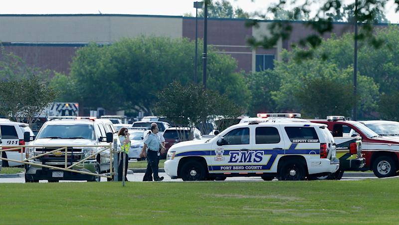 Emergency medical personnel stage in the Santa Fe High School parking lot.