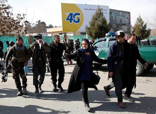 <p>Afghan security forces members and civilians assist the injured after a blast in Kabul, Afghanistan , Jan. 27, 2018. (Photo: Mohammad Ismail/Reuters) </p>