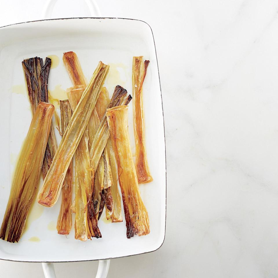 """How good are leeks? So good you only need olive oil to do them justice. This is the definitive dish among leek recipes and an easy add-on to your repertoire. <a href=""""https://www.epicurious.com/recipes/food/views/olive-oil-roasted-leeks-51252390?mbid=synd_yahoo_rss"""" rel=""""nofollow noopener"""" target=""""_blank"""" data-ylk=""""slk:See recipe."""" class=""""link rapid-noclick-resp"""">See recipe.</a>"""