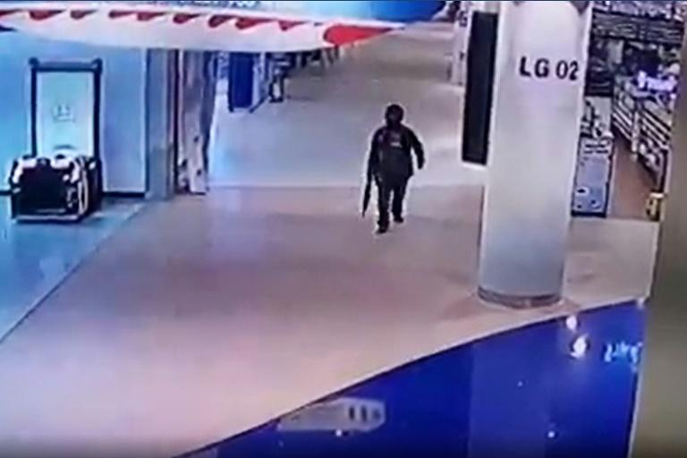 Jakrapanth walks through the shopping mall, in a video grab created from a handout video released by a Thai television station