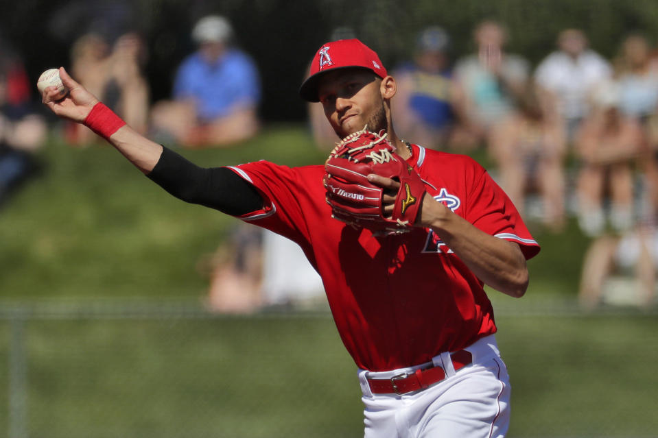 FILE - In this Wednesday, March 4, 2020 file photo, Los Angeles Angels' Andrelton Simmons throws the ball against the Seattle Mariners during the second inning of a spring training baseball game in Tempe, Ariz. The Minnesota Twins and shortstop Andrelton Simmons have agreed to a $10.5 million, one-year contract, according to a person familiar with the negotiations. The person spoke to The Associated Press on condition of anonymity because the agreement is subject to a physical exam.(AP Photo/Matt York, File)