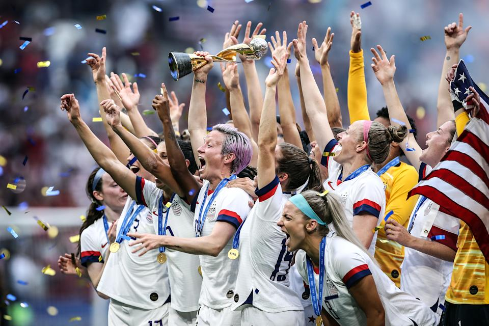 LYON, FRANCE - JULY 07: (EDITORS NOTE: Image has been digitally enhanced.) Megan Rapinoe of the USA lifts the FIFA Women's World Cup Trophy following her team's victory in the 2019 FIFA Women's World Cup France Final match between The United States of America and The Netherlands at Stade de Lyon on July 07, 2019 in Lyon, France. (Photo by Alex Grimm/Getty Images)