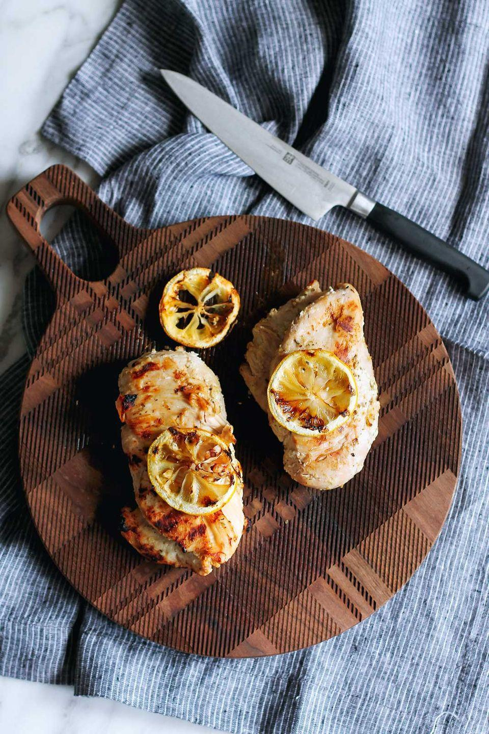 """<p>This chicken by<a href=""""https://www.ambitiouskitchen.com/5-ingredient-grilled-lemon-yogurt-marinated-chicken/"""" rel=""""nofollow noopener"""" target=""""_blank"""" data-ylk=""""slk:Ambitious Kitchen"""" class=""""link rapid-noclick-resp""""> Ambitious Kitchen</a> makes dinner a snap during the week, as it requires only 5 ingredients and can be made in bulk for leftovers. Plain grilled chicken is a terrific health food, since it's lean protein and low in calories. And the Greek yogurt and olive oil have gut health and anti-inflammatory benefits, respectively, as well.</p>"""