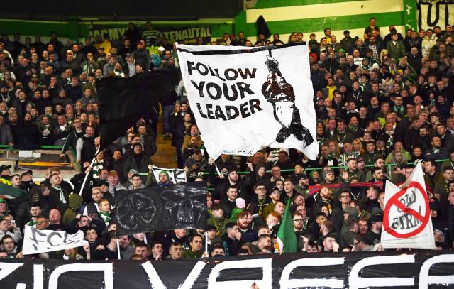 Celtic fans display banners (Credit: Getty Images)