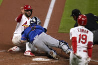 St. Louis Cardinals' Ali Sanchez, left, is tagged out at home by New York Mets catcher Tomas Nido as Cardinals' Tommy Edman (19) watches ending the second inning in the second game of a baseball doubleheader Wednesday, May 5, 2021, in St. Louis. (AP Photo/Jeff Roberson)