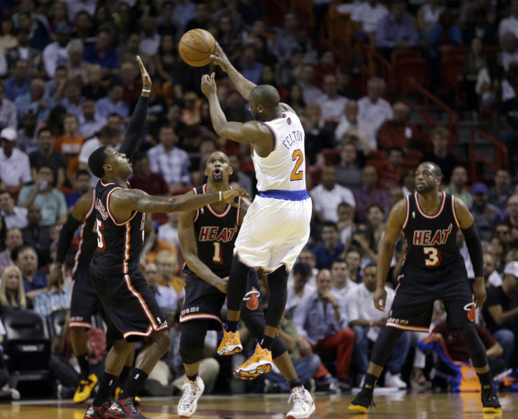 New York Knicks point guard Raymond Felton (2) passes against the Miami Heat during the first half of an NBA basketball game in Miami, Thursday, Feb. 27, 2014. (AP Photo/Alan Diaz)