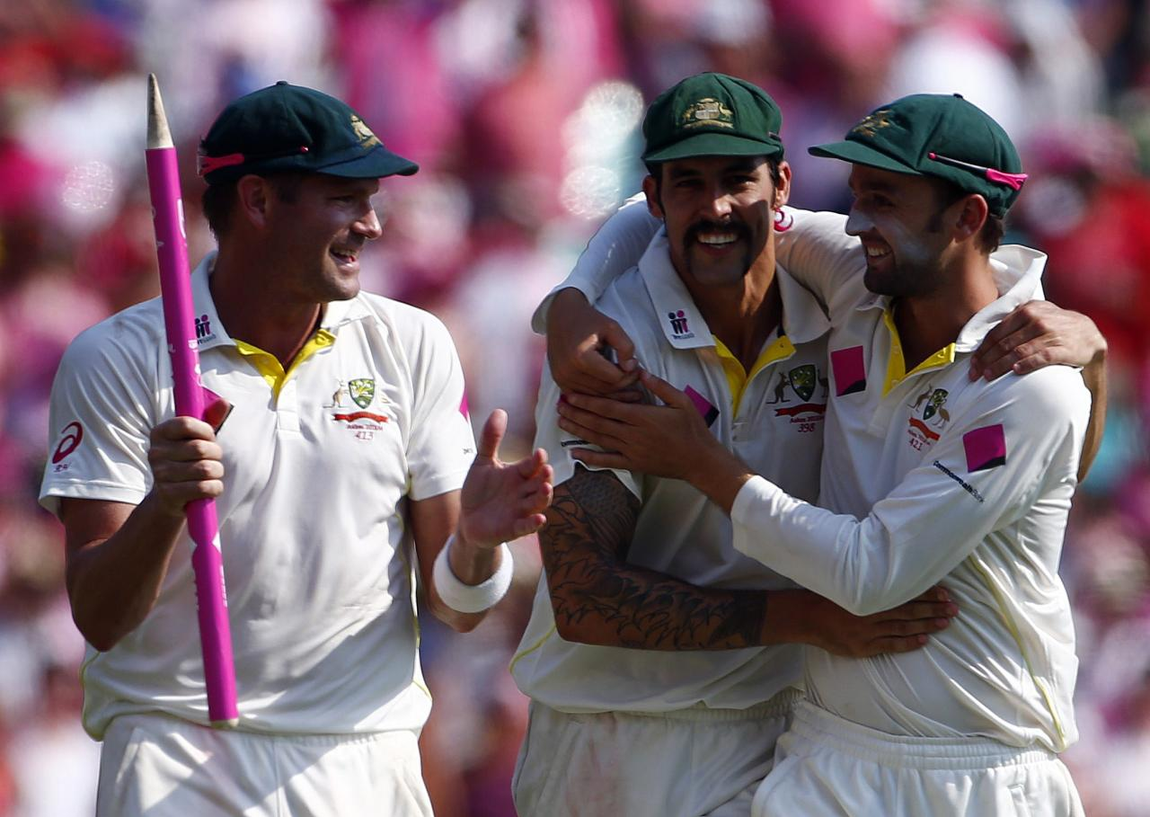 Australia's Nathan Lyon (R), Mitchell Johnson (C) and Ryan Harris celebrate after winning the fifth Ashes cricket test against England at the Sydney Cricket Ground January 5, 2014. A rampant Australia sealed a 5-0 Ashes series sweep by skittling England out for 166 to claim a 281-run victory with more than two days to spare in the fifth test at the Sydney Cricket Ground on Sunday. REUTERS/David Gray (AUSTRALIA - Tags: SPORT CRICKET)