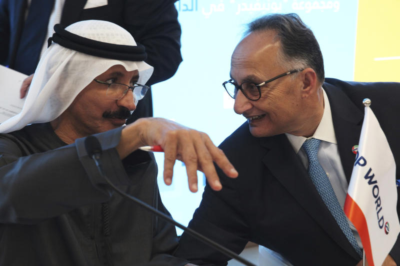 Sultan Ahmed bin Sulayem, the group chairman and CEO of Dubai-backed port operator DP World, left, speaks with DP World's Chief Financial Officer Yuvraj Narayan, in Dubai, United Arab Emirates, Thursday, March 14, 2019. Global port operator DP World said Thursday its profit rose 10 percent in 2018, overcoming worldwide tensions over trade amid a trade war between China and the U.S. and fears about Britain leaving the European Union. (AP Photo/Jon Gambrell)