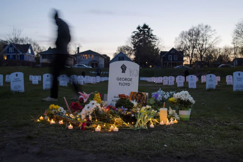 """A local resident walks along the """"Say Their Names"""" cemetery on the day of verdict in the trial of former Minneapolis police officer Derek Chauvin, found guilty of the death of George Floyd, at George Floyd Square in Minneapolis, Minnesota, U.S."""