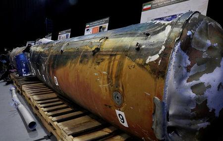 """Weapon that Pentagon says is """"QIAM"""" ballistic missile manufactured in Iran fired from Yemen into Saudi Arabia is seen on display at military base in Washington"""
