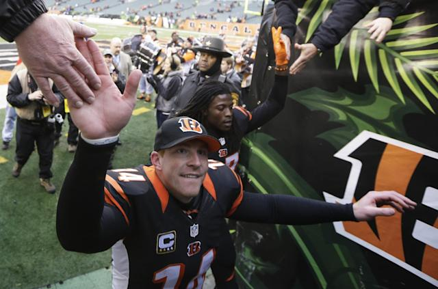 Cincinnati Bengals quarterback Andy Dalton (14) leaves the field after defeating the Baltimore Ravens 34-17 in an NFL football game on Sunday, Dec. 29, 2013, in Cincinnati. (AP Photo/Tom Uhlman)