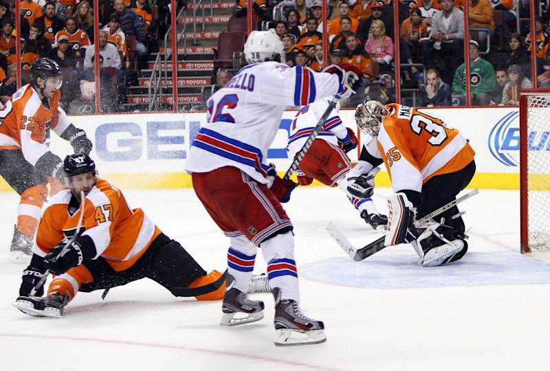 Philadelphia Flyers' Steve Mason, right, makes a glove save during the second period in Game 6 of an NHL hockey first-round playoff series against the New York Rangers, Tuesday, April 29, 2014, in Philadelphia. (AP Photo/Chris Szagola)