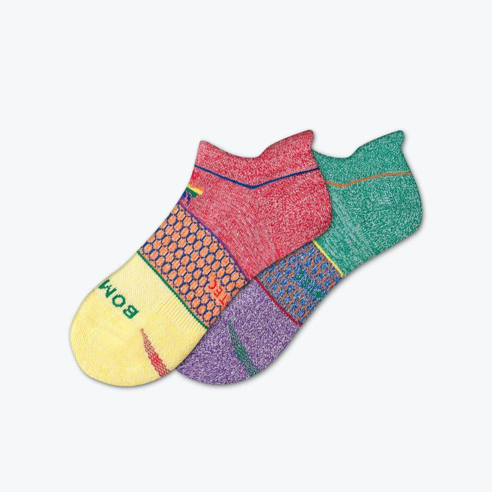 """<p>bombas.com</p><p><strong>$16.00</strong></p><p><a href=""""https://bombas.com/products/pride-all-purpose-performance-ankle-socks?variant=rainbow&size=m"""" rel=""""nofollow noopener"""" target=""""_blank"""" data-ylk=""""slk:Shop Now"""" class=""""link rapid-noclick-resp"""">Shop Now</a></p><p>""""I'm always in need of extra ankle socks, and for each pair of this colorful style sold, Bombas will donate a pair to an organization helping those affected by homelessness in the LGBTQ+ community.""""—<em>Caroline Hallemann, Digital News Director</em></p>"""