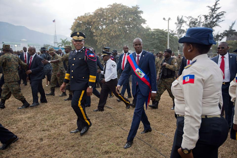 Newly sworn-in Haitian President Jovenel Moise walks with Police Chief Michel-Ange Gedeon past National Police at the National Palace after his inauguration ceremony in 2017 (AP)