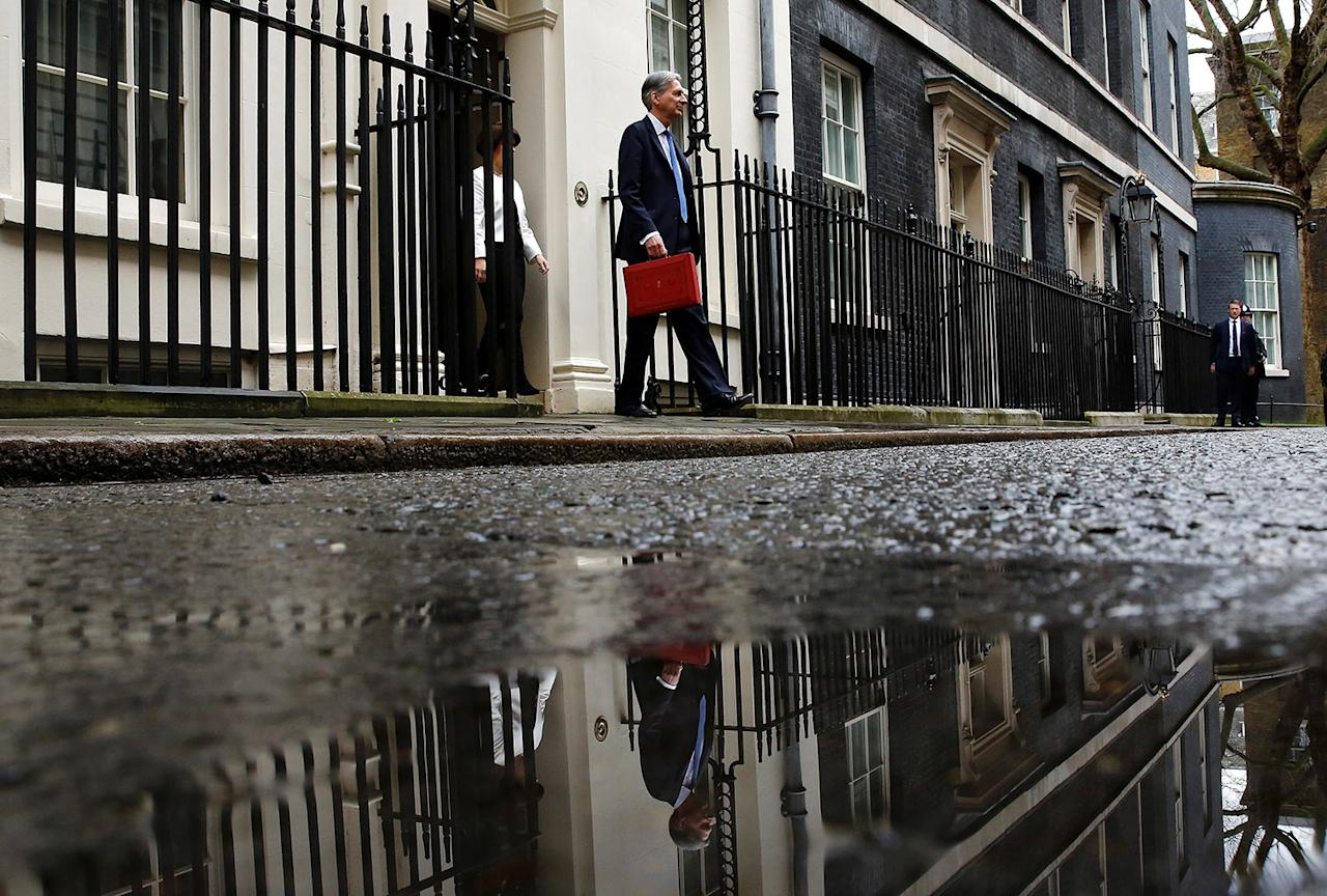 <p>Britain's Chancellor of the Exchequer Philip Hammond stands outside 11 Downing Street before delivering his budget to the House of Commons in London, March 8, 2017. (Photo: Stefan Wermuth/Reuters) </p>